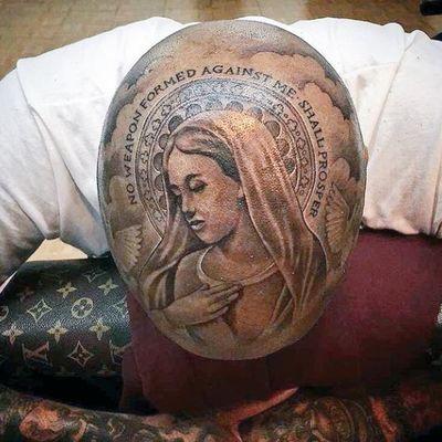 Tatuaggio della Madonna sulla capa di YG